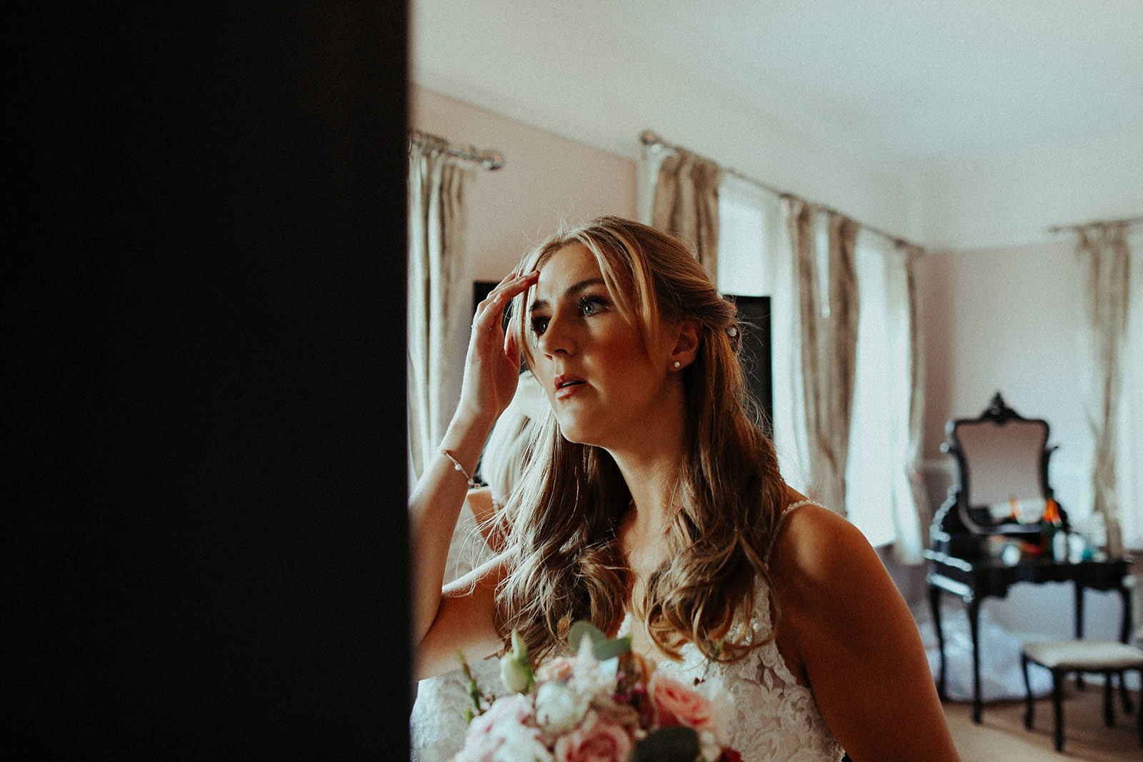 bride checking herself in a mirror