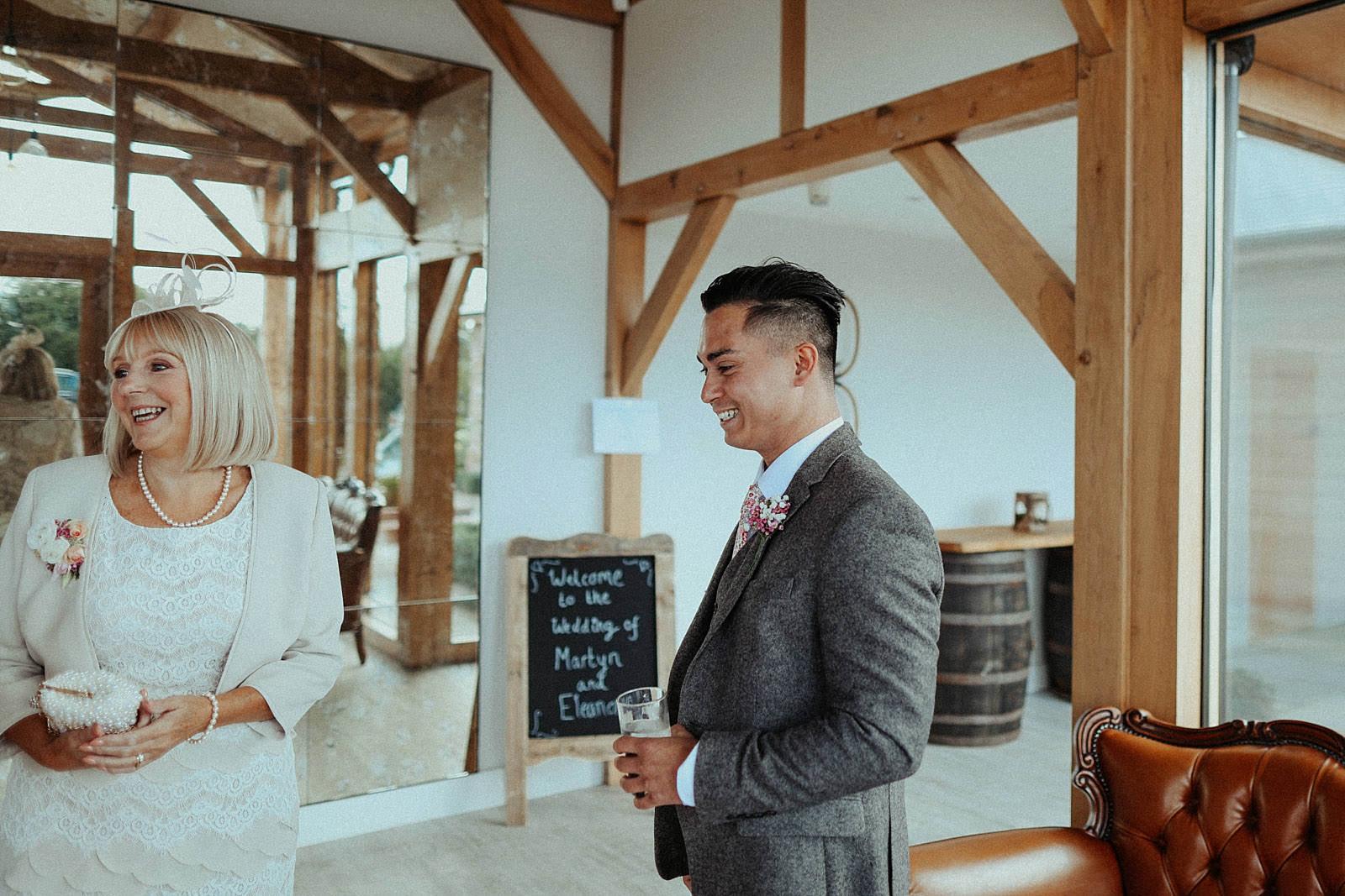 smiling groom in tweed suit