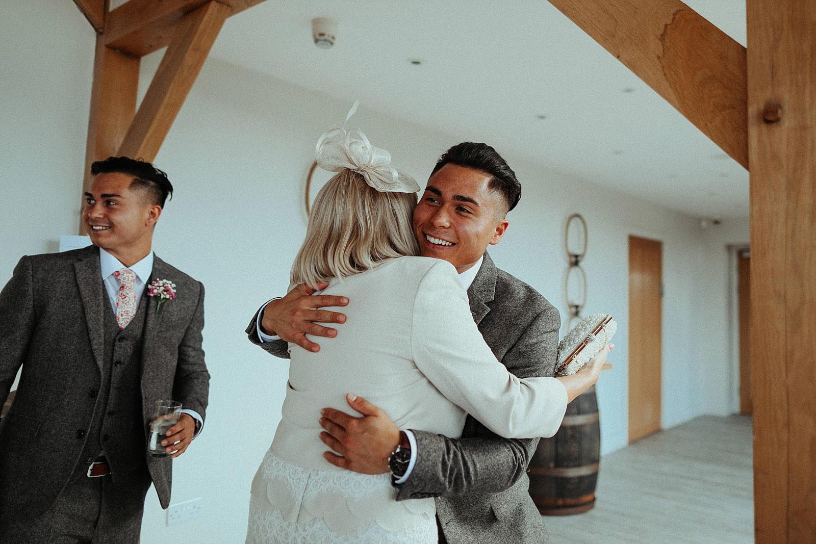 groom hugs his mother in law