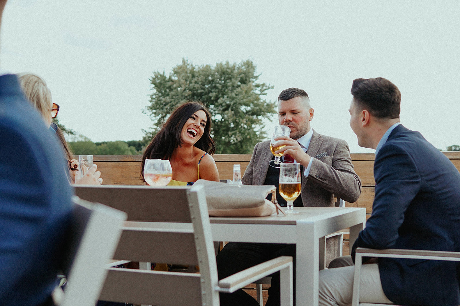 beer drinking wedding guests
