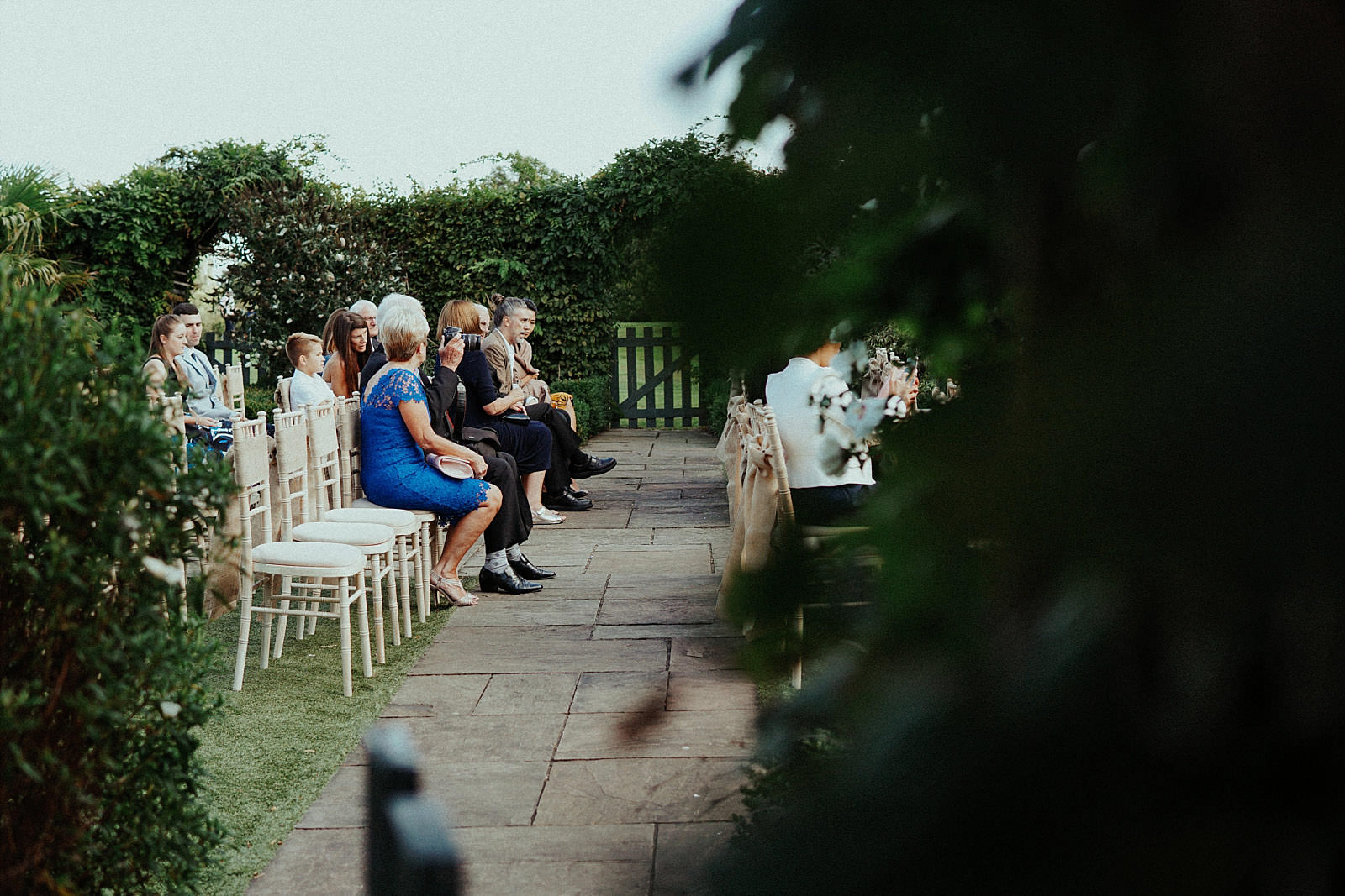 seated guests at an outdoor ceremony
