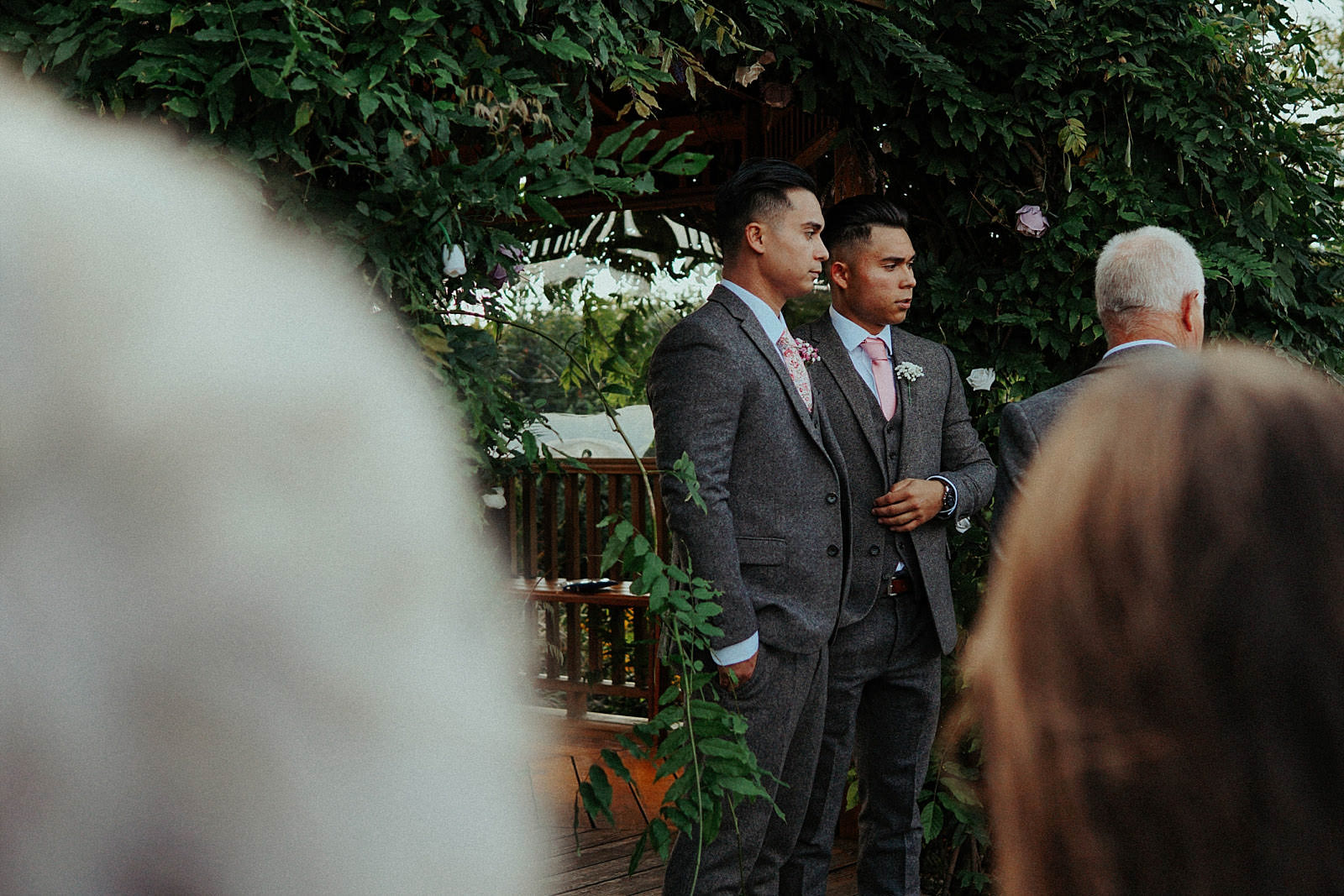 groom and best man at the top of the aisle