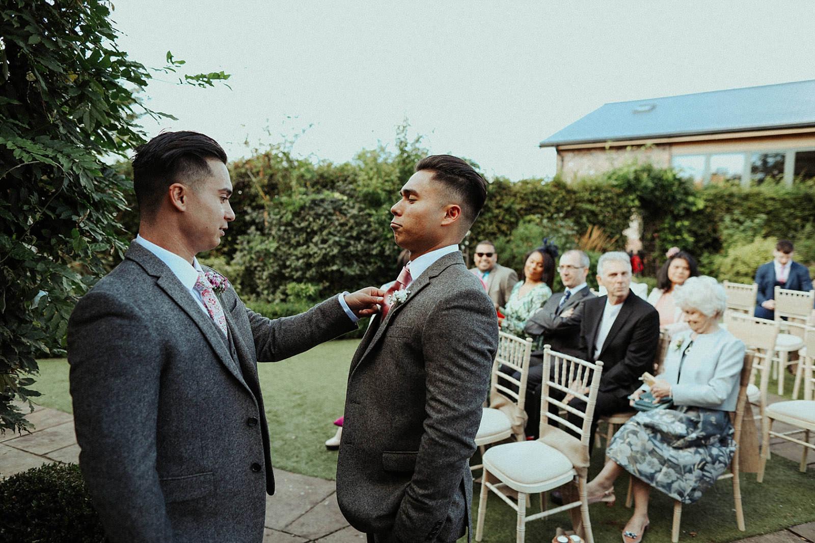 groom fixing best mans pocket square