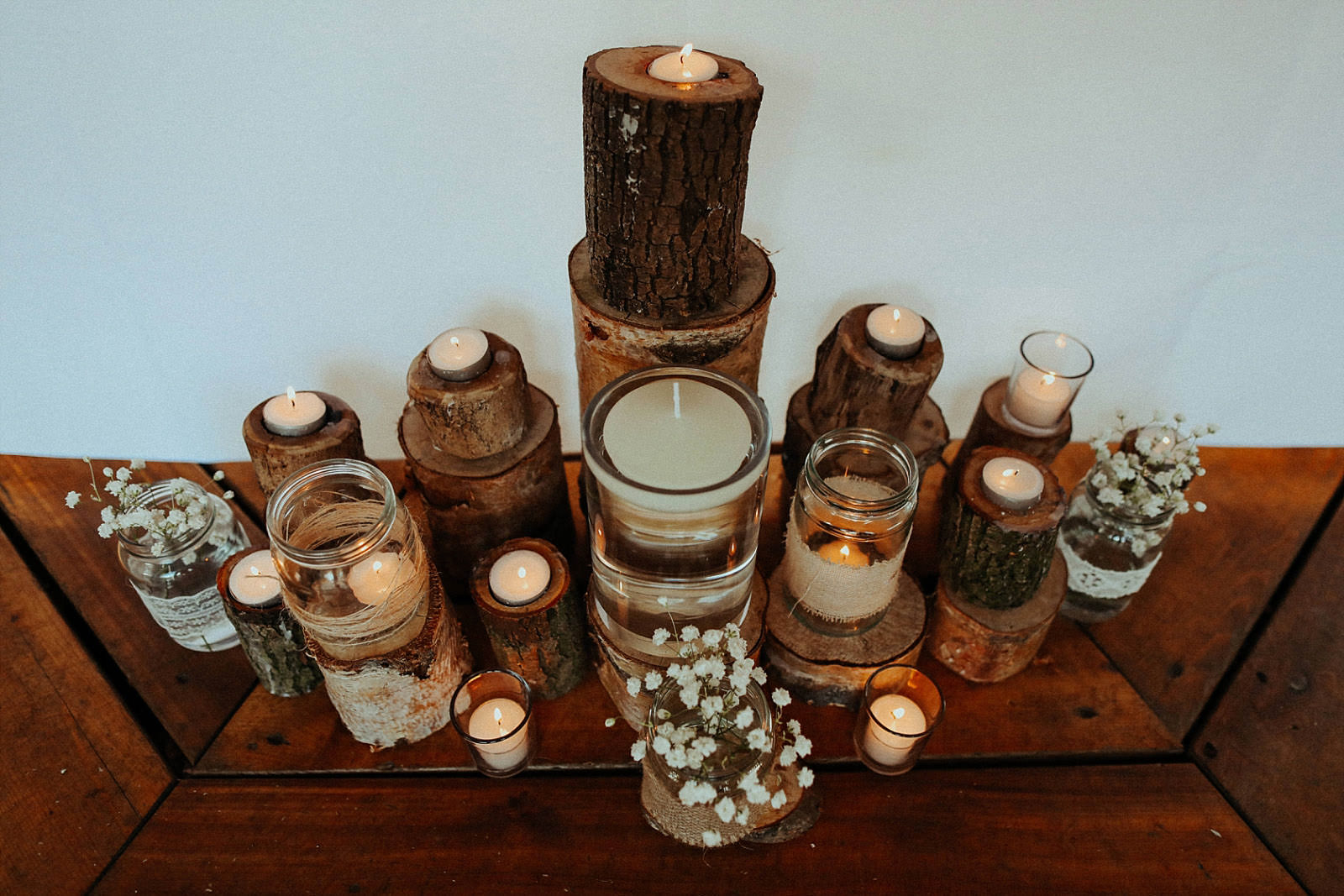 rustic wood with candles sitting on top