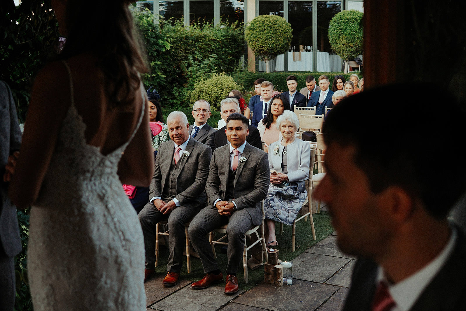 guests watch the wedding ceremony