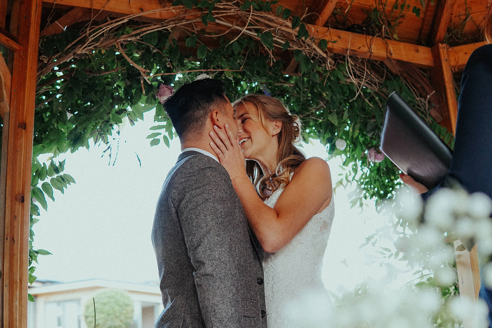 bride and groom kissing after saying i do