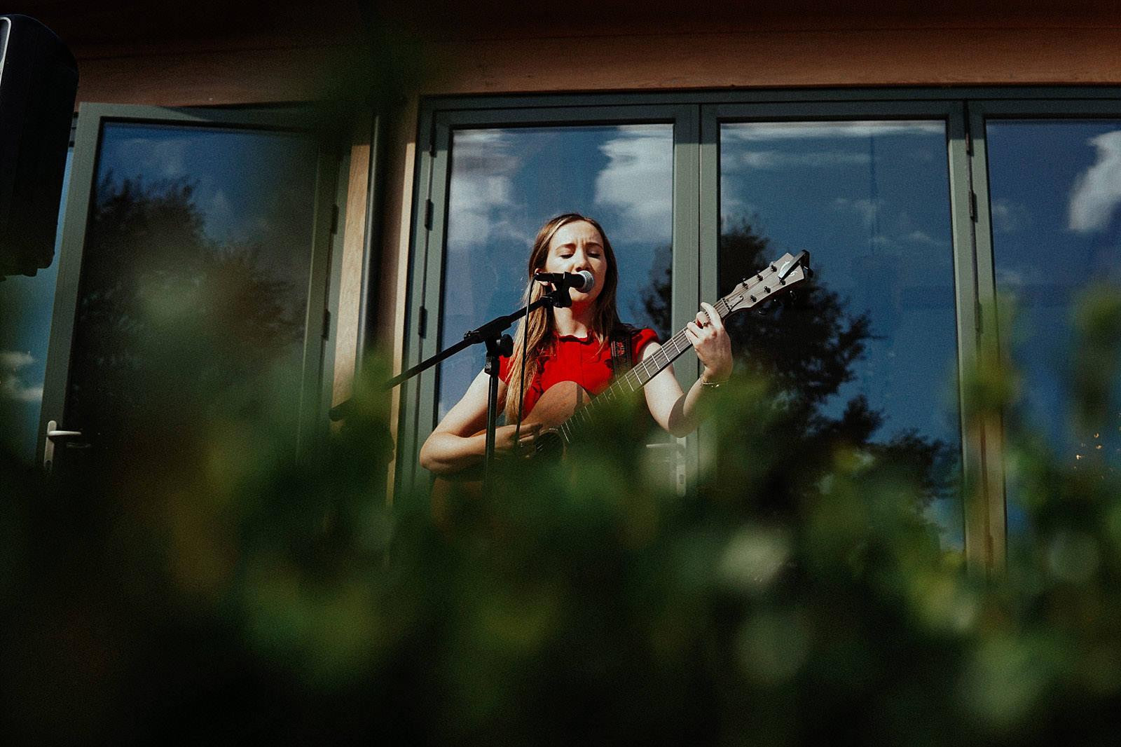 lucy mayhew wedding singer at a wedding