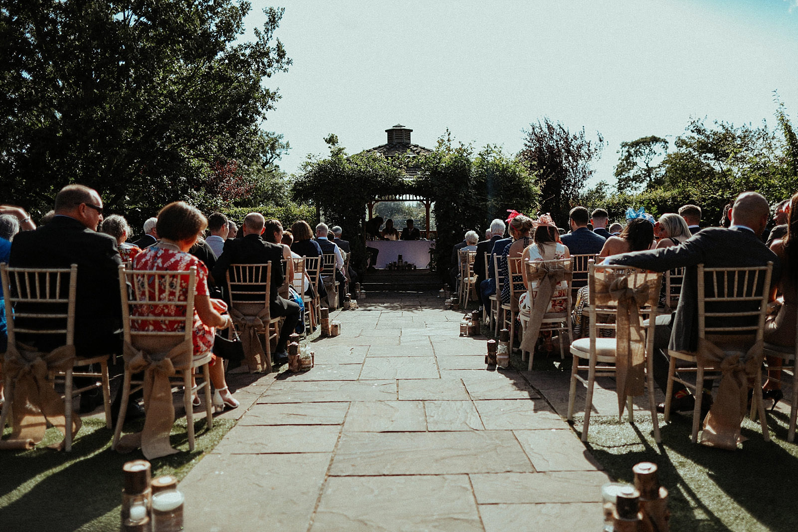 a shot down the aisle at pryor hayes outdoor wedding venue