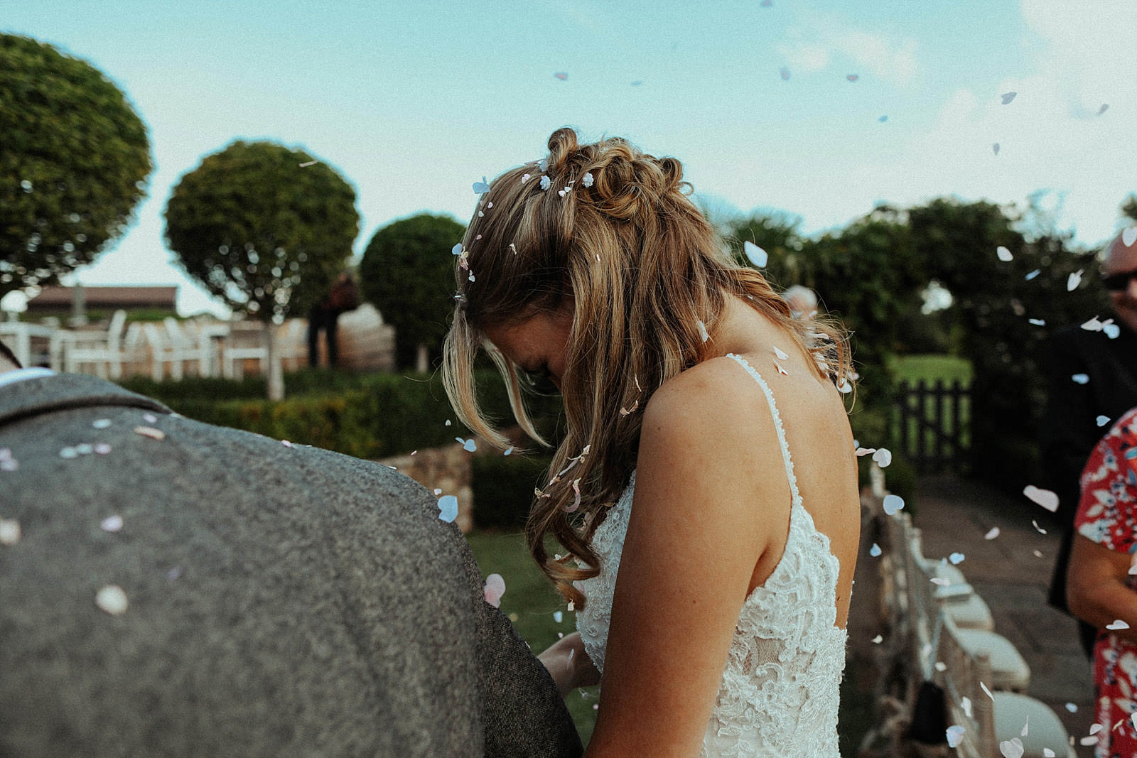brides hair covered in confetti