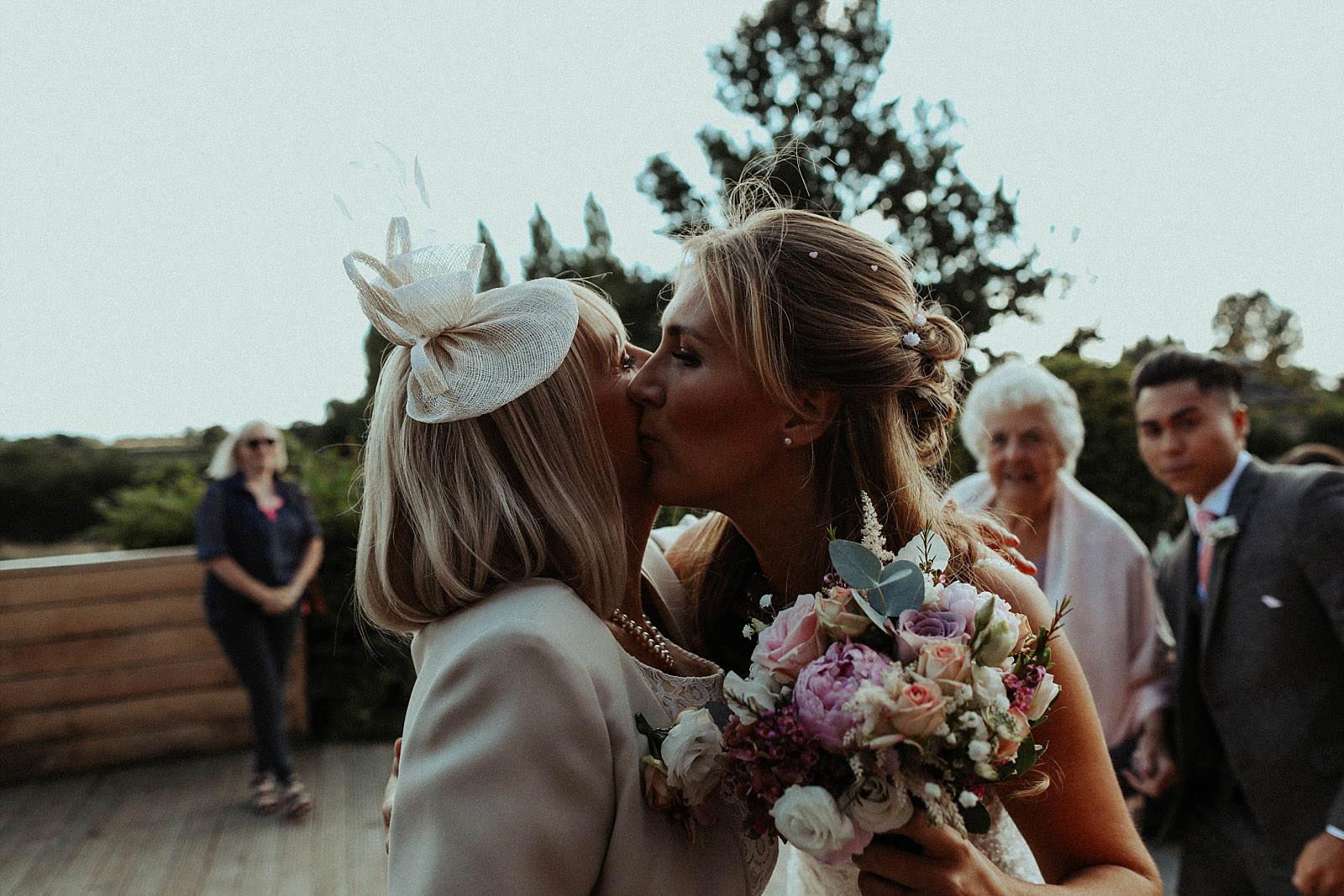 bride kisses her mum
