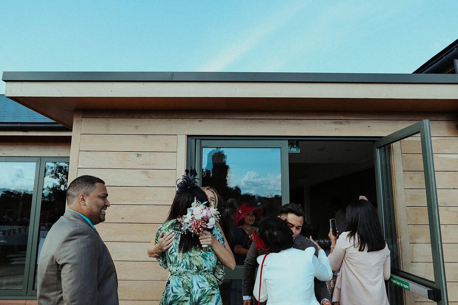 hugging guests at a wedding