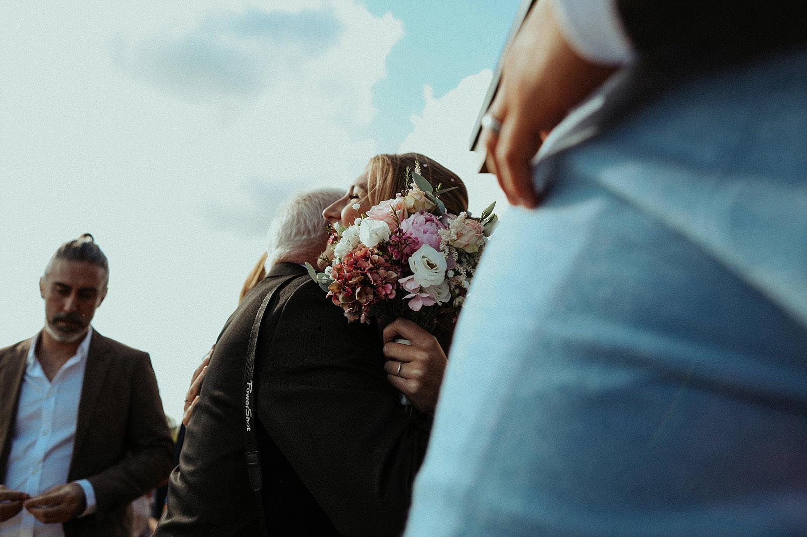 bride hugs guests