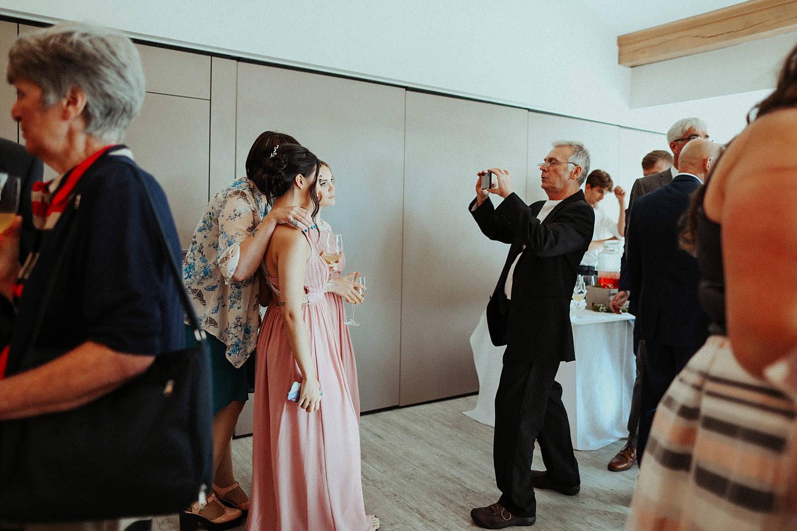 man taking photo at a wedding