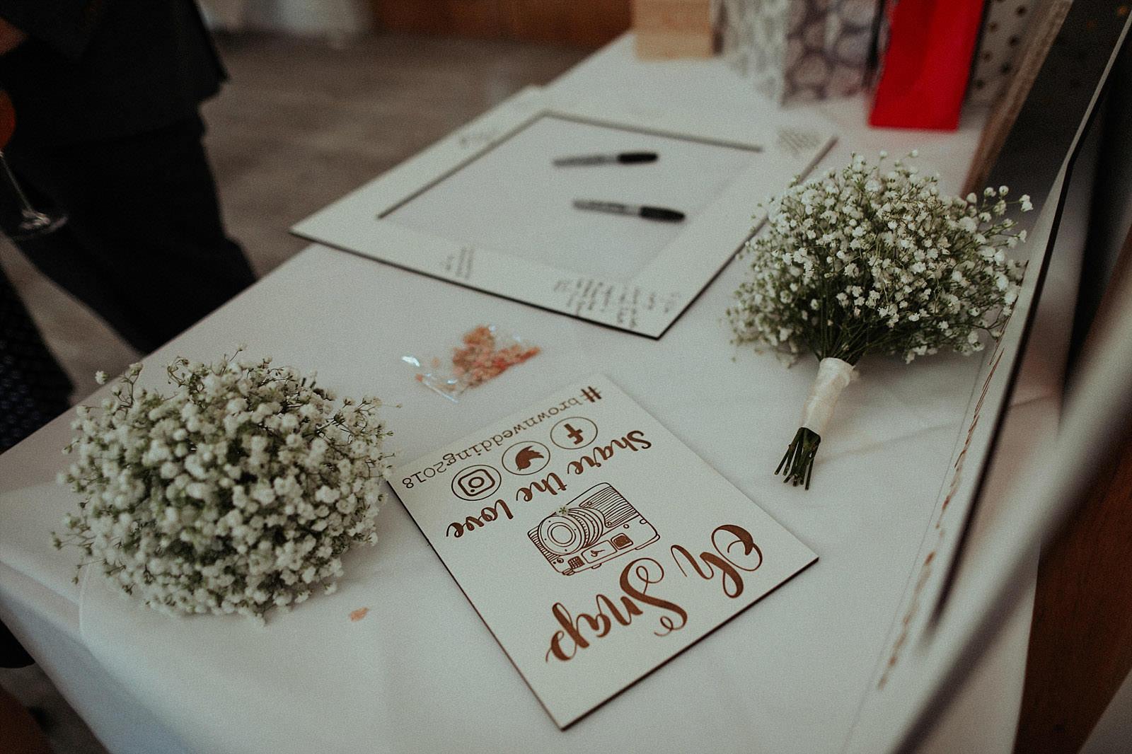 siging board at a wedding