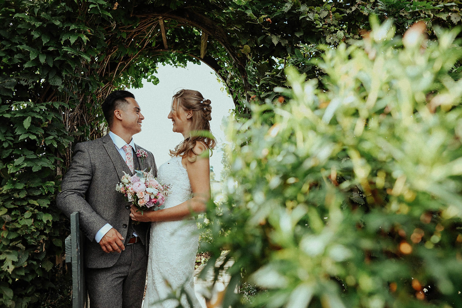 bride and groom in the gardens at pryors hayes wedding venue