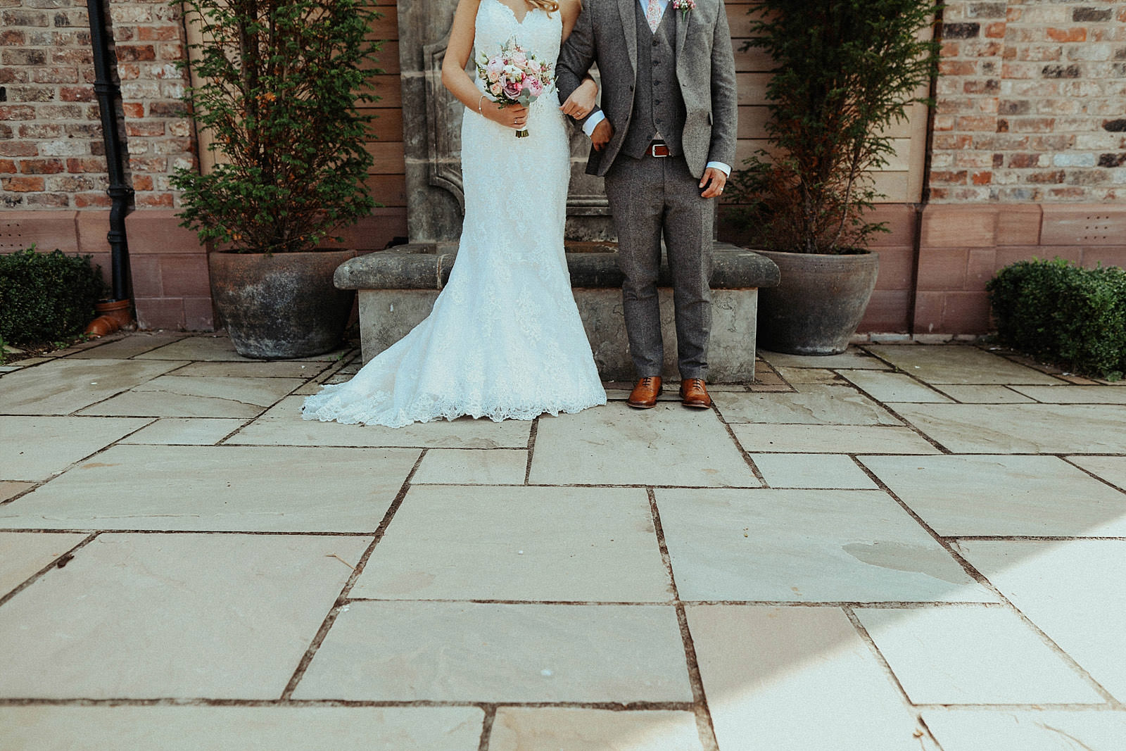 bottom half of brides dress and grooms suit and shoes