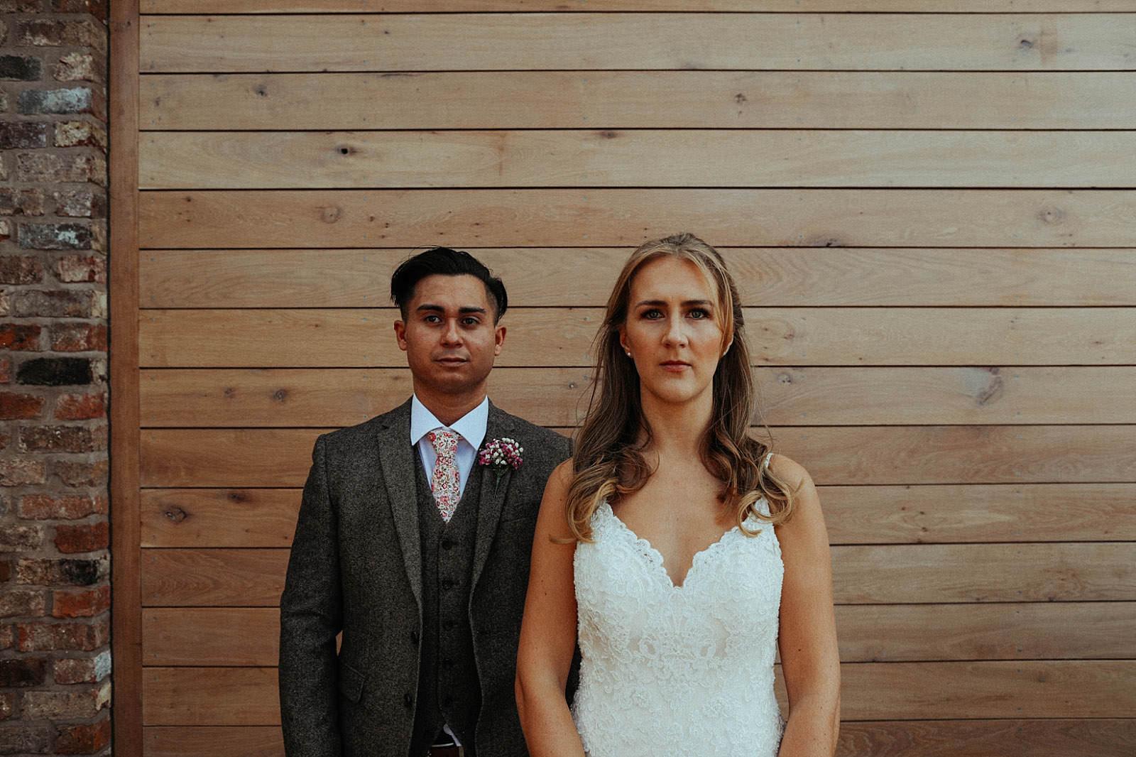 bride and groom looking straight ahead.