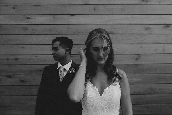 bride tucks her hair behing her head