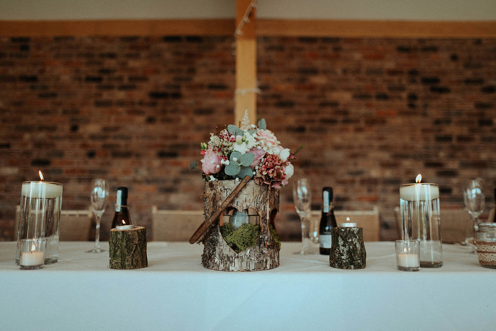 rustic and whimsical weddingtable logs and candles