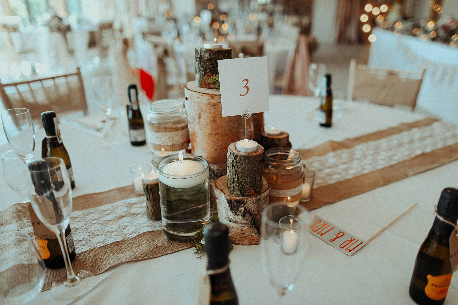 logs and candle for wedding table centres