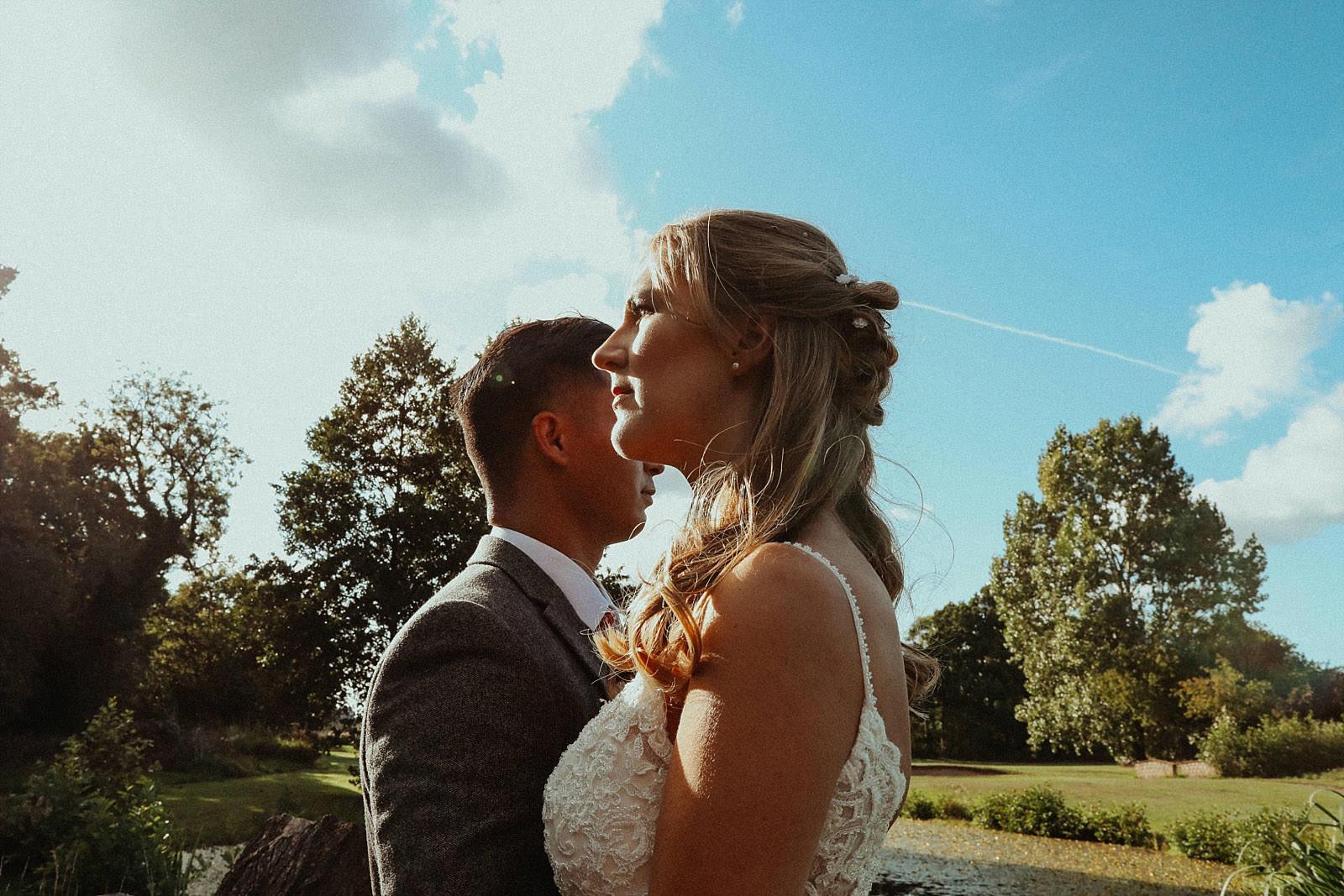 bride posing in front off groom
