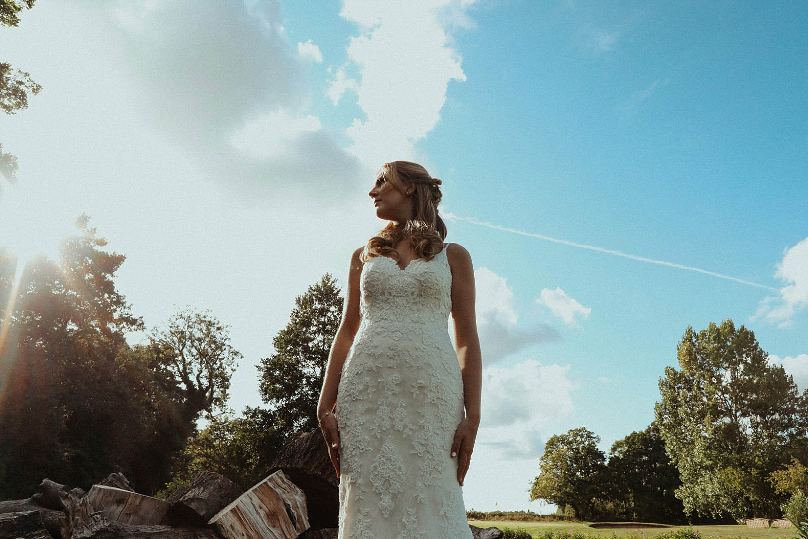 beautiful bride and sky in background