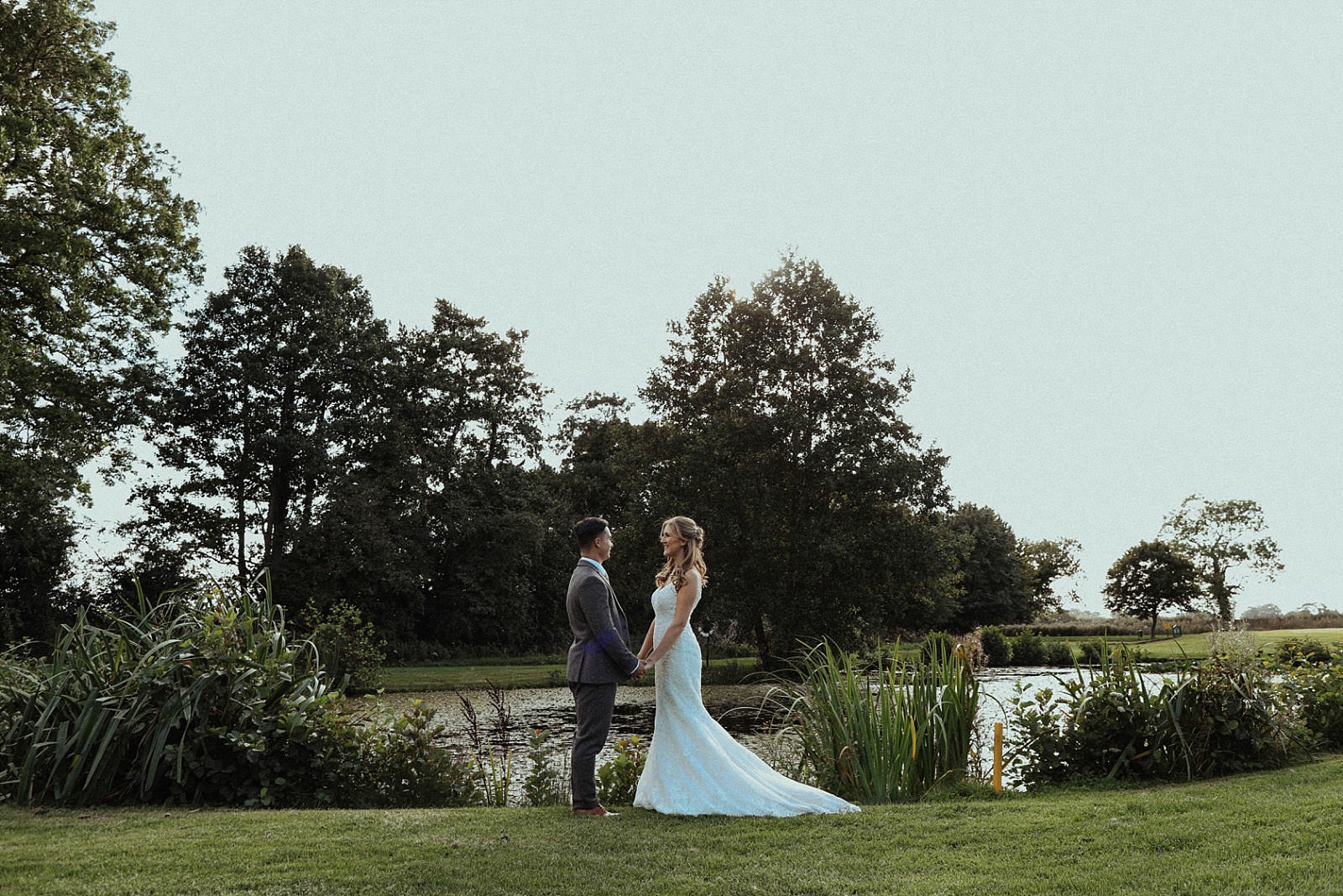bride and groom portraits with lake in background