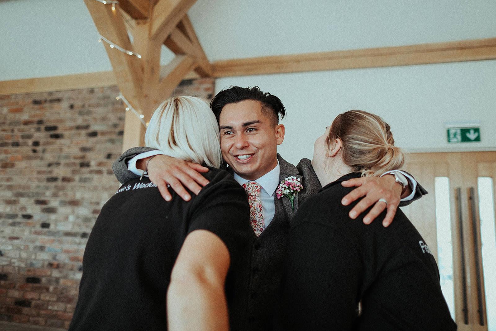 groom hugs the staff at Pryor hayes