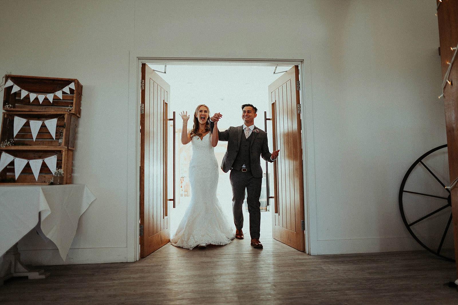 bride and groom make grand enterance