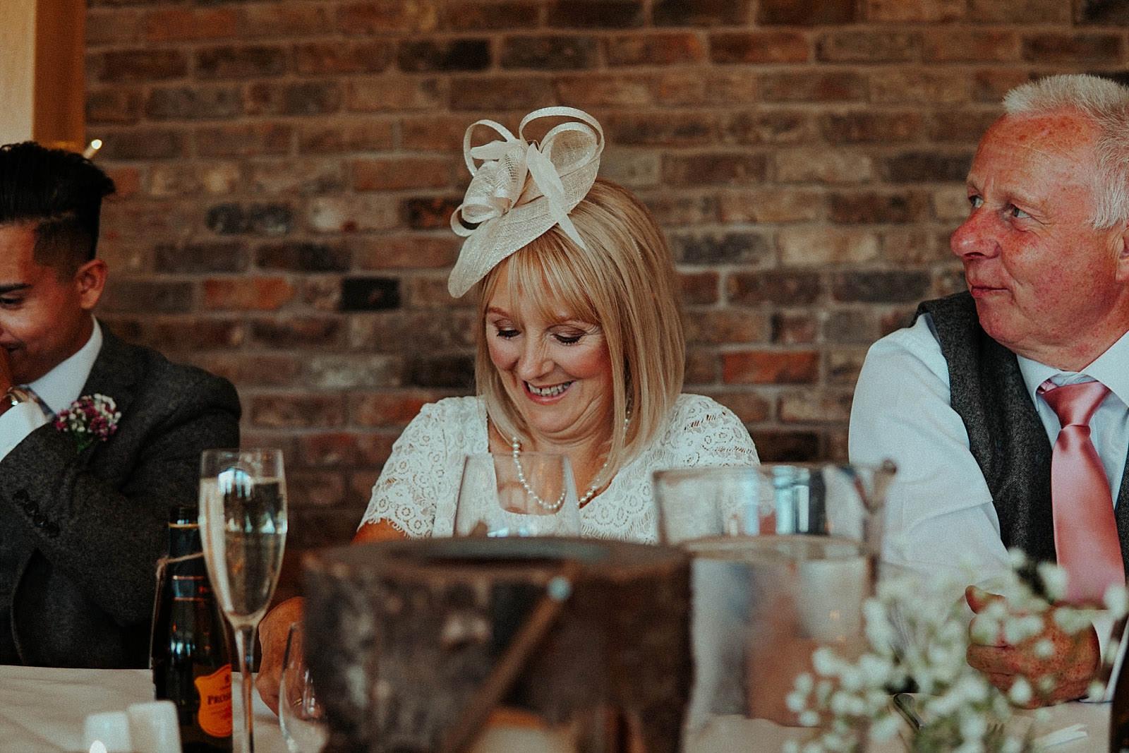 brides mum smiling at speeches
