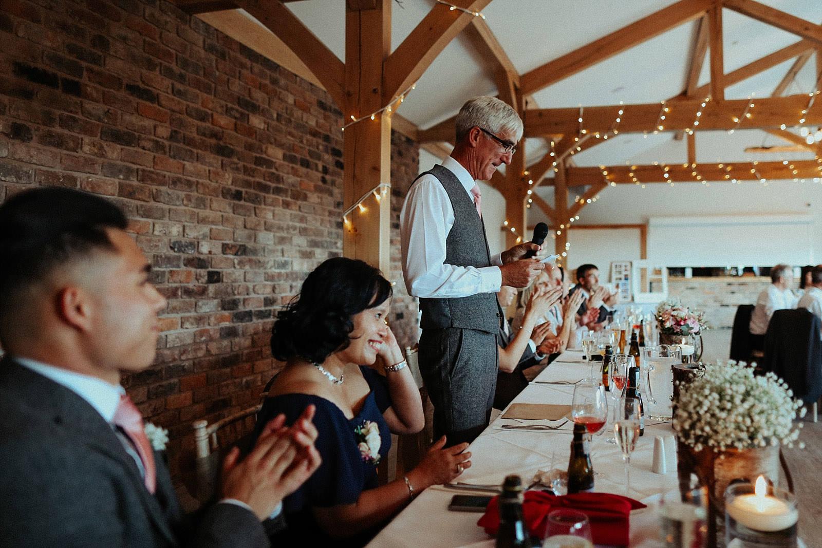 brides dad stood up doing a speech