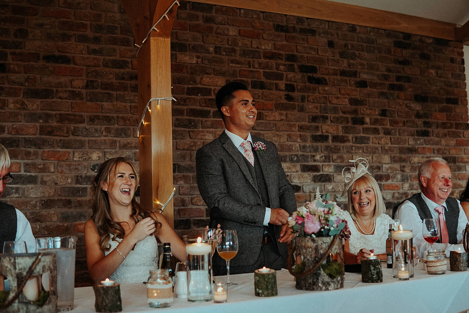groom stands up to give his wedding speech