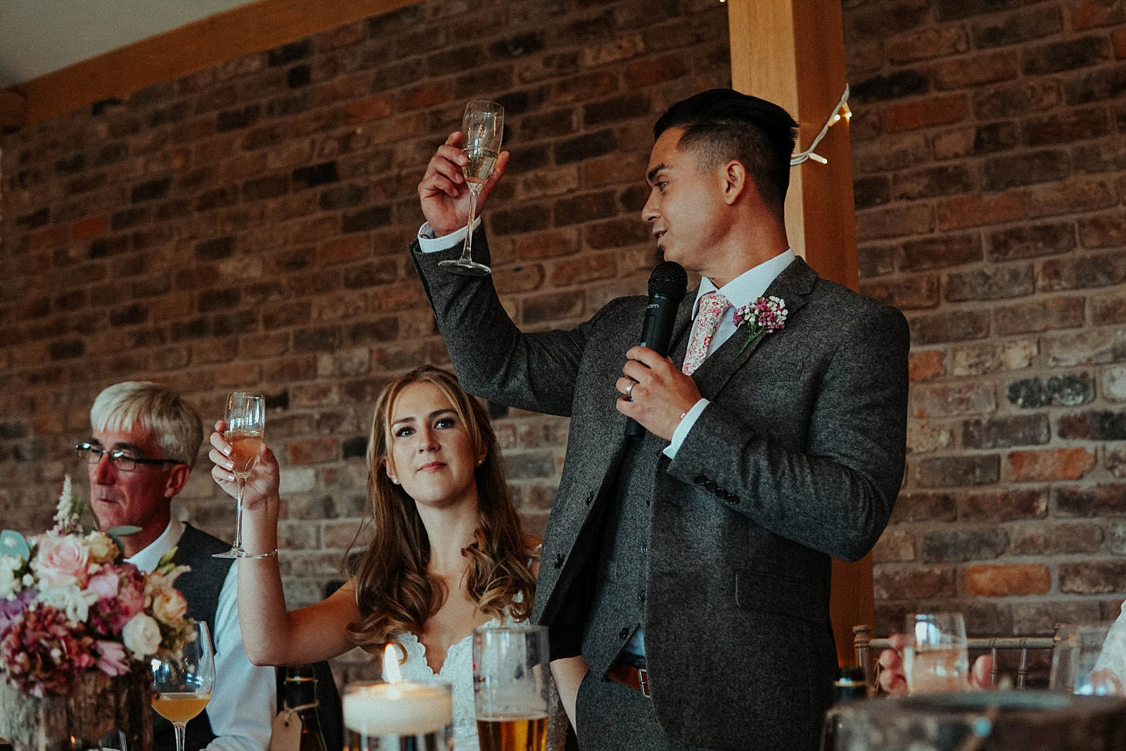 groom raising a glass to the wedding guests