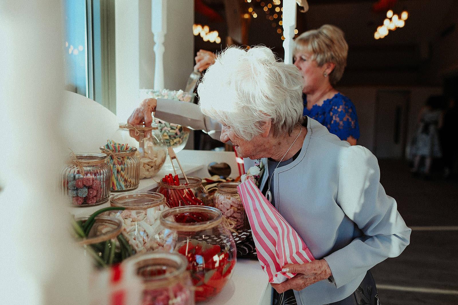 grandma picking sweets at wedding
