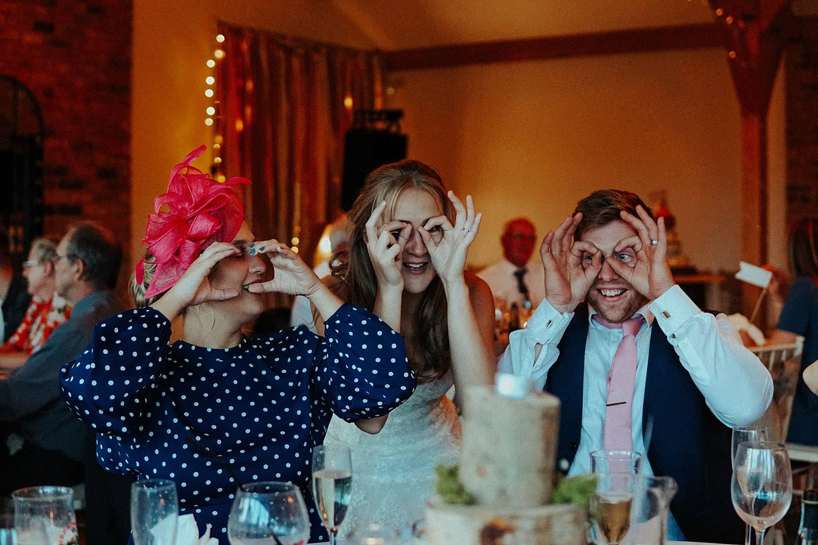 people playing buck eye game at a wedding