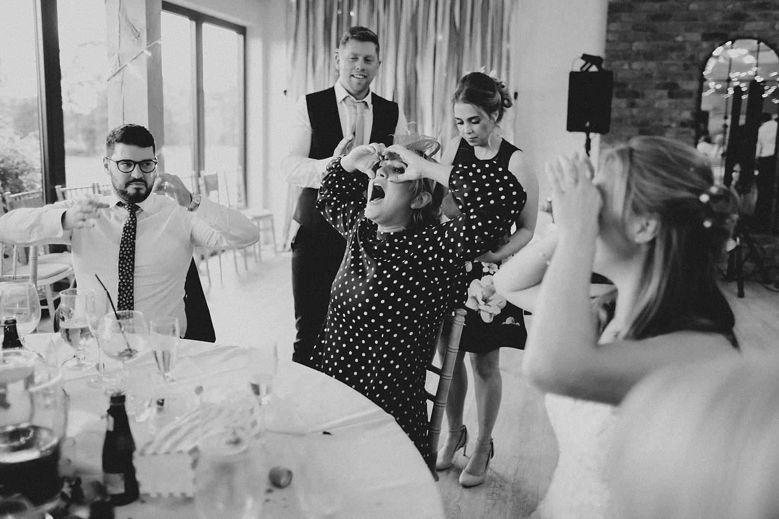 woman playing buck eye at a wedding