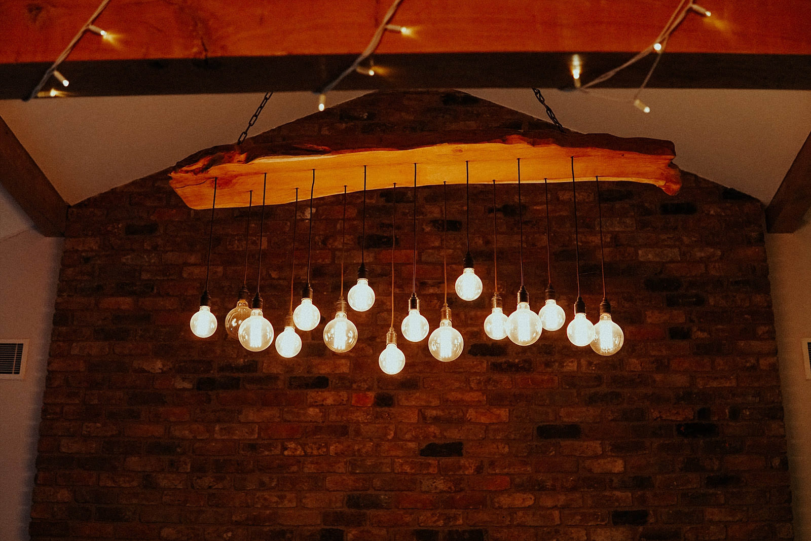 trendy lights hanging from solid oak beam