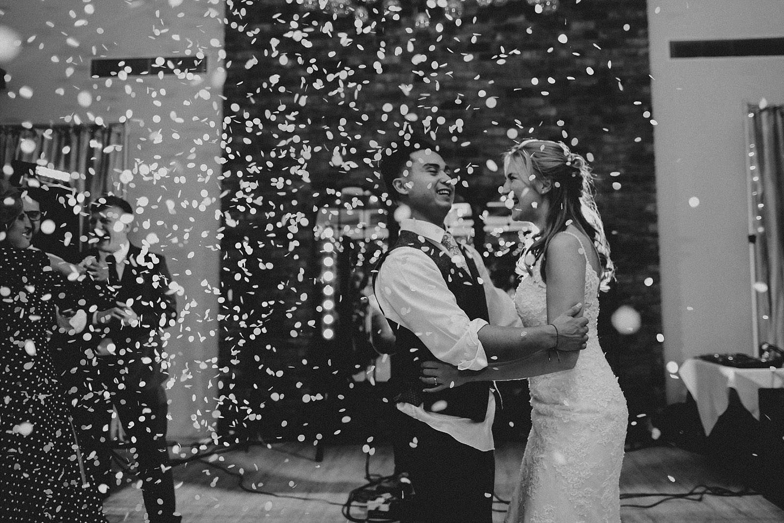 confetti falls for the bride and groom during first dance