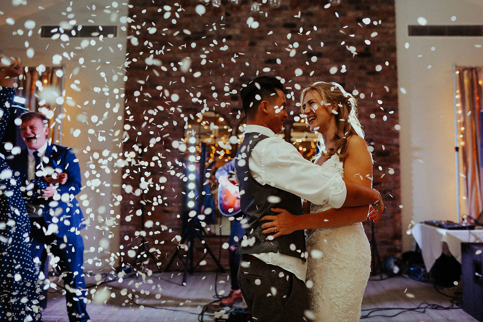 bride and groom dancing in confetti during their first dance