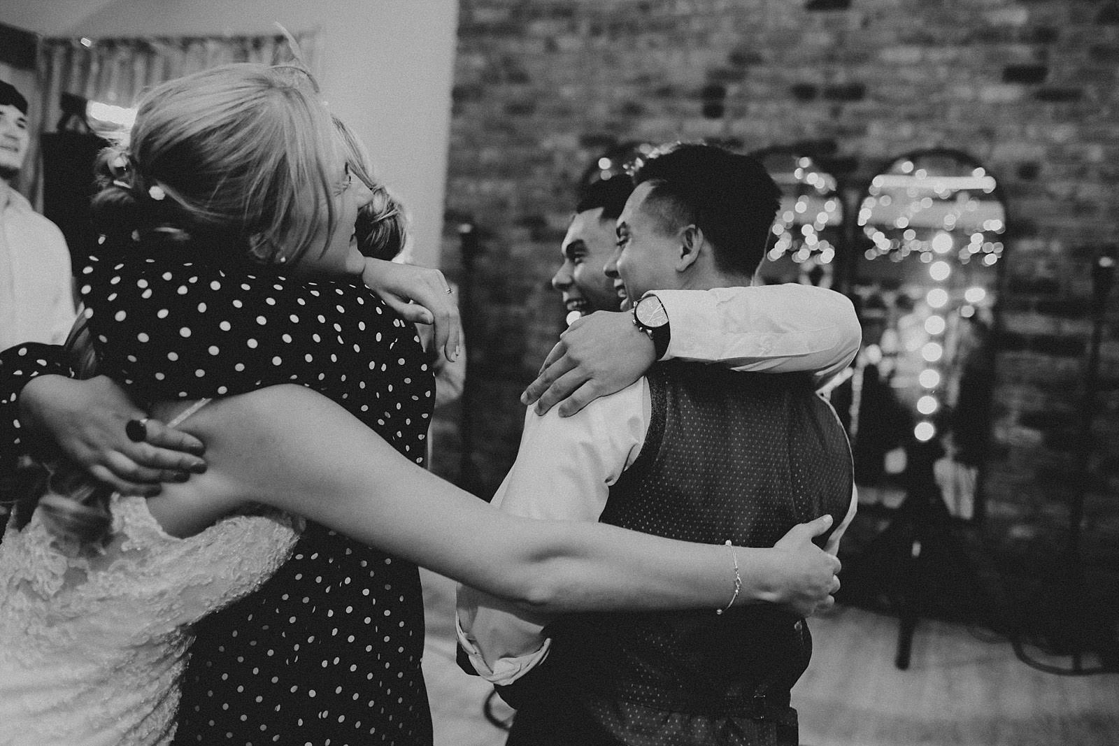 guest hugging groom after first dance
