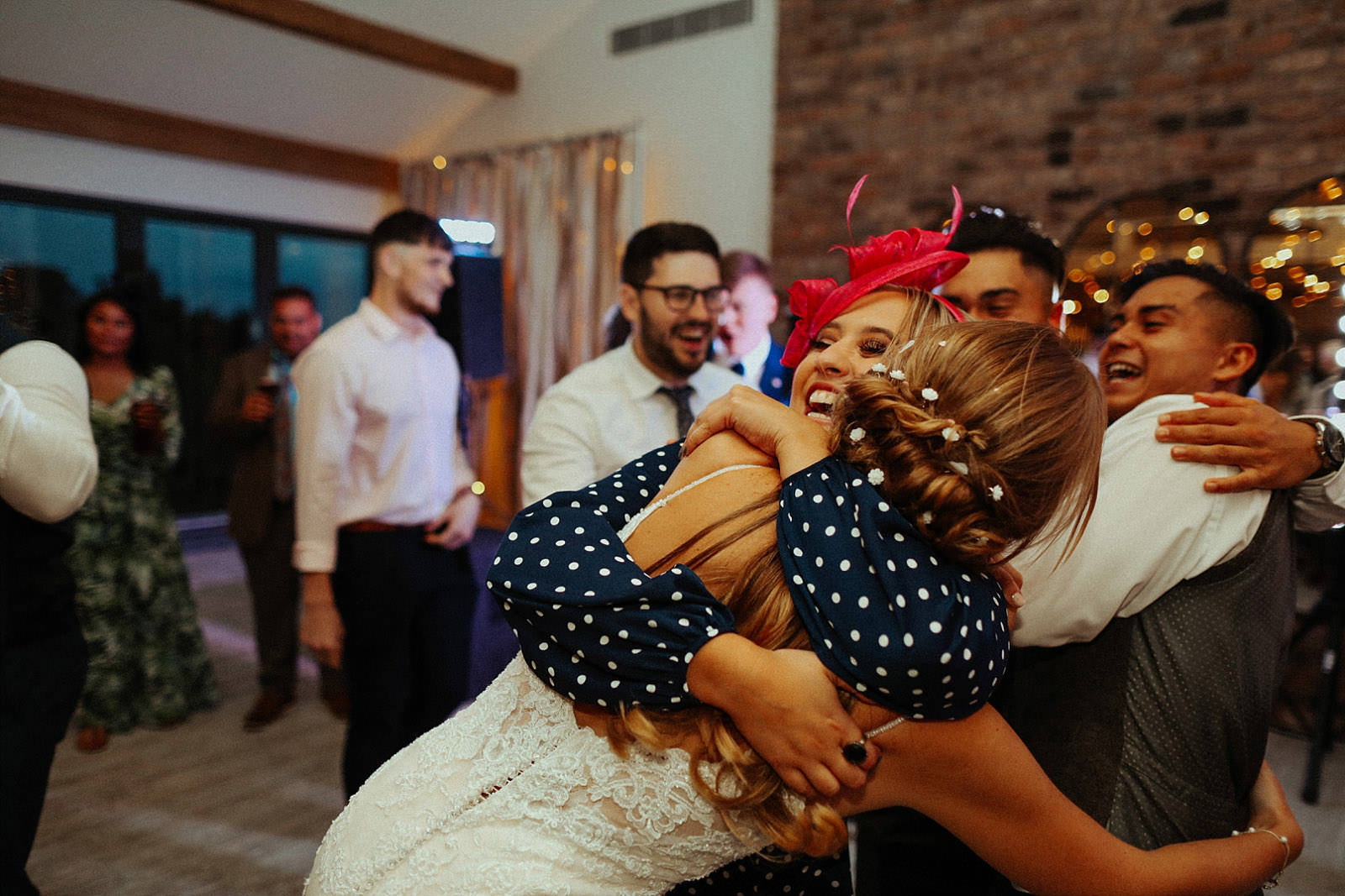 woman throws her arms around bride