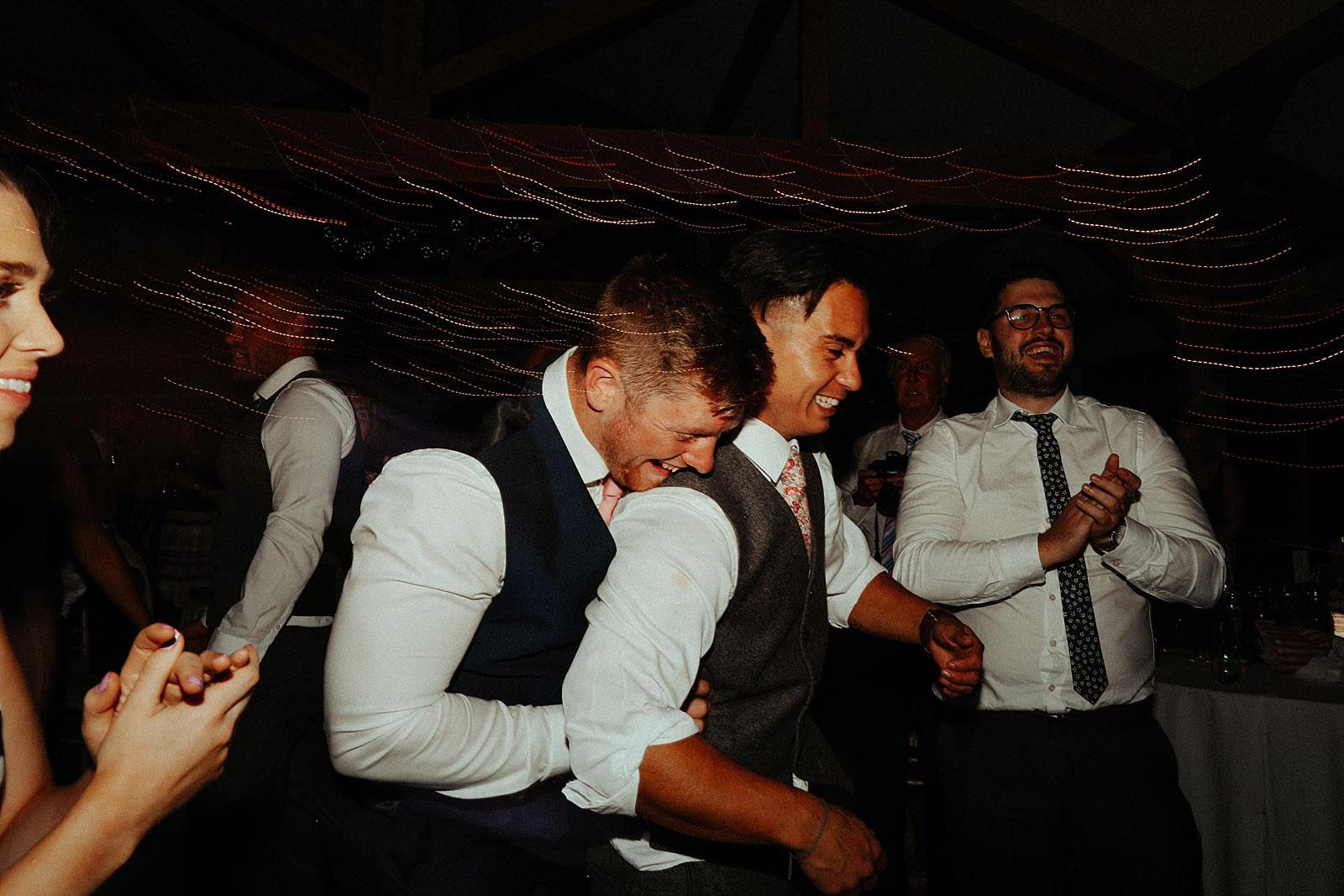 the men dancing at wedding