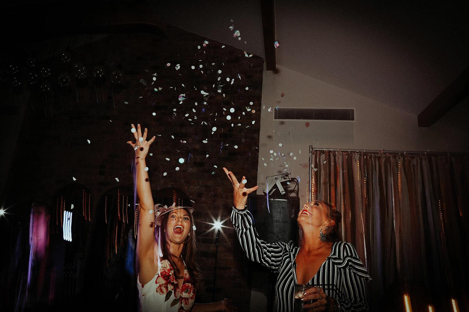 woman throw confetti in the air