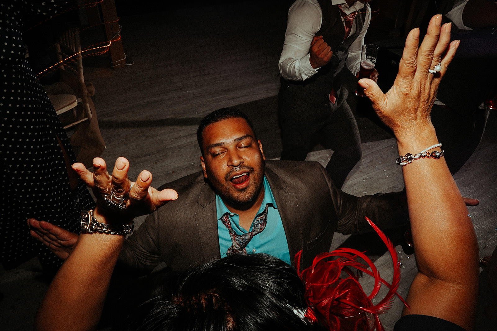 crazy man dancing at a wedding