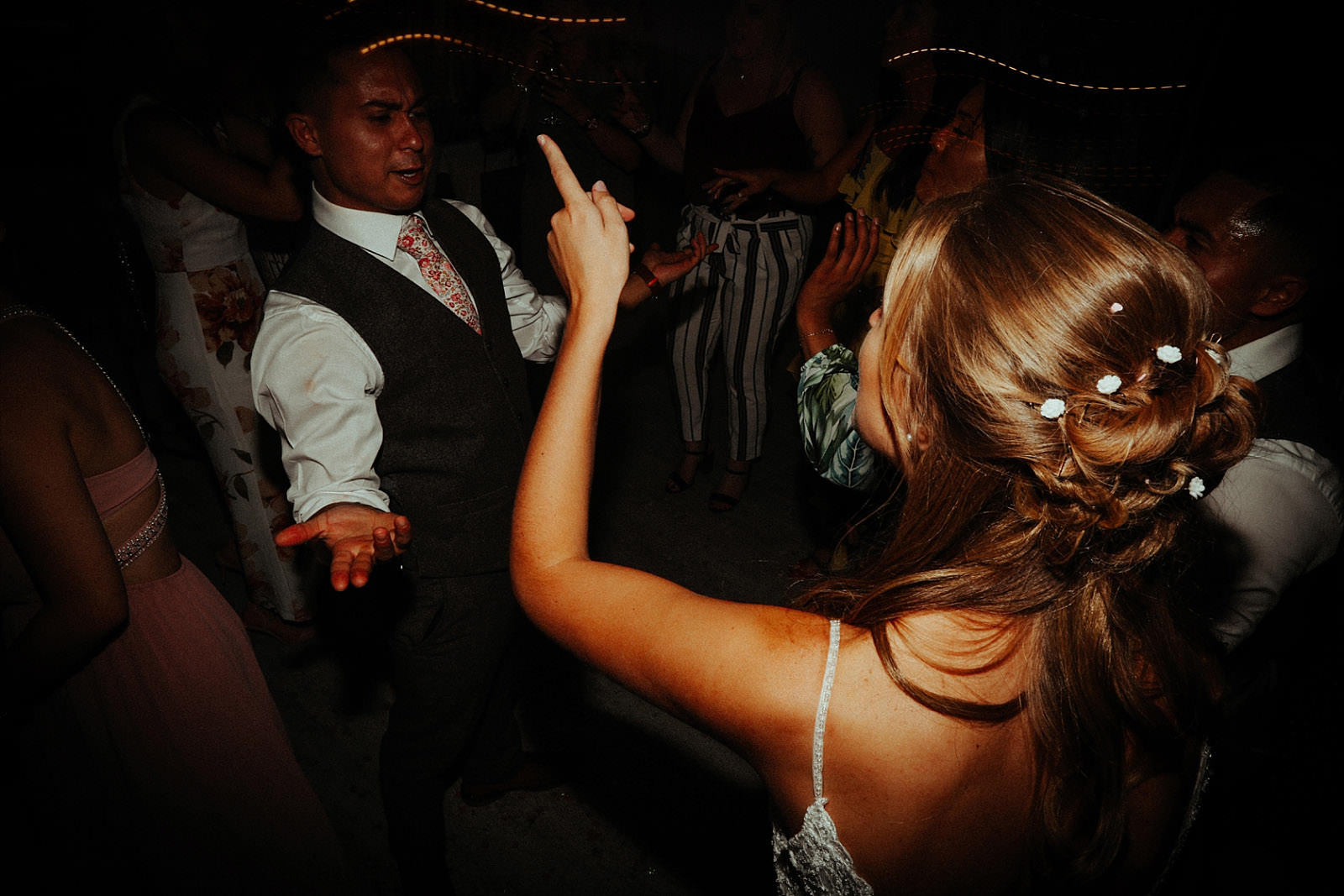 bride pointing finger during dance