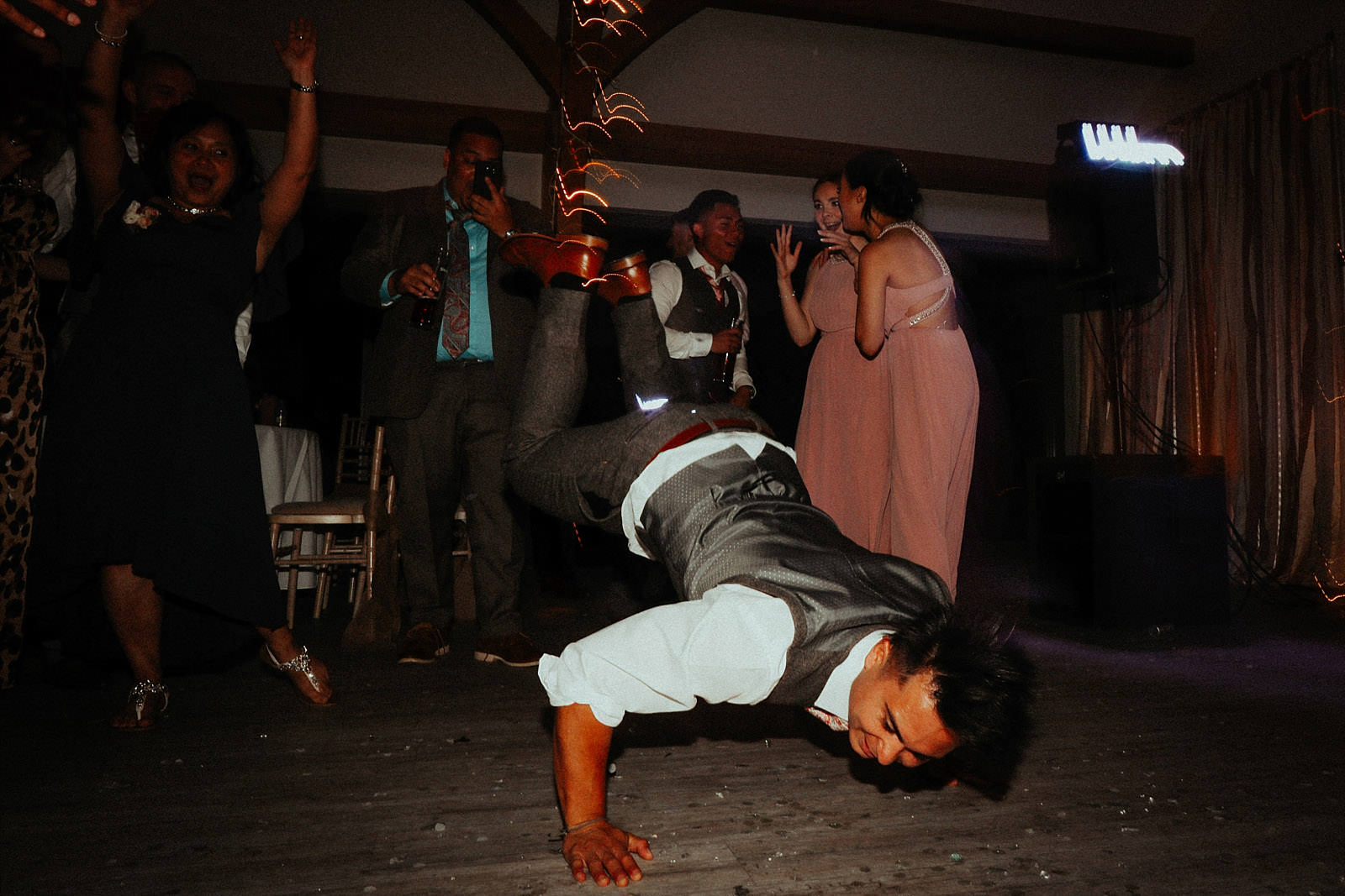 groom doing the worm at a wedding