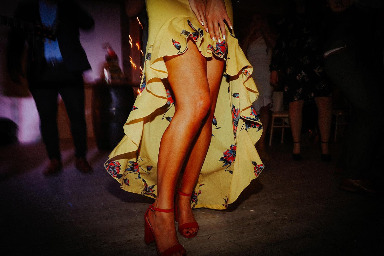 womans legs dancing on the dance floor