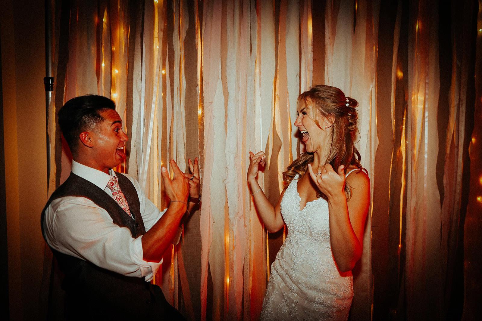 bride and groom rocking hands