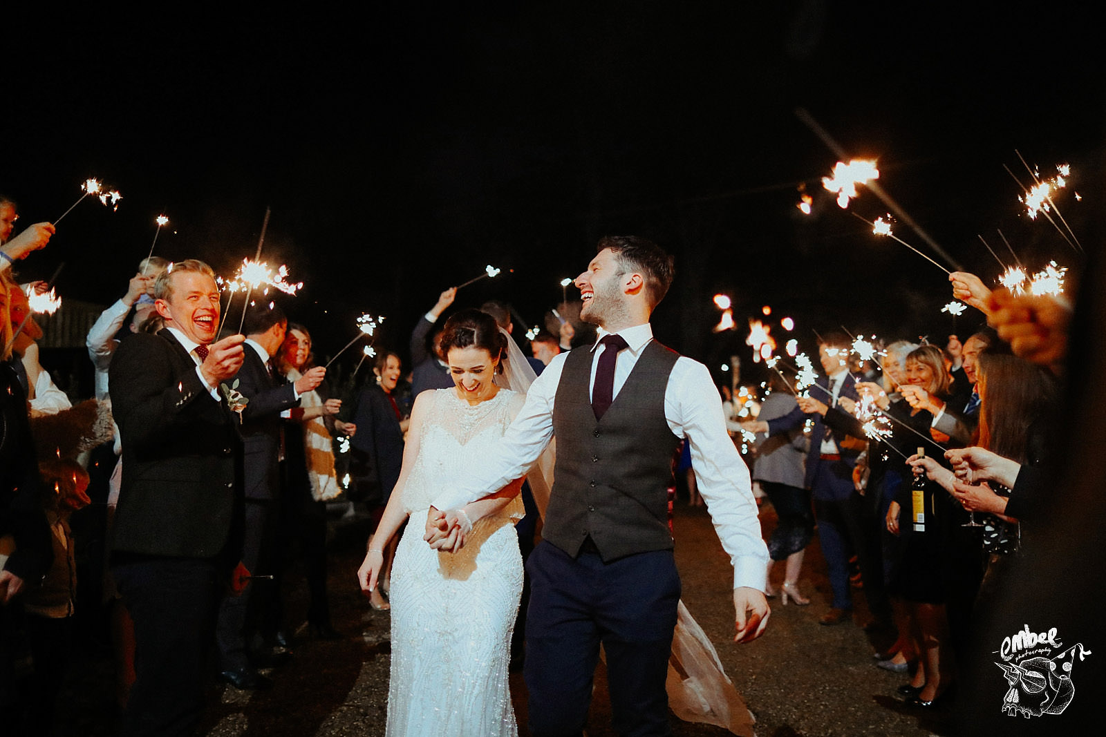 guest surround bride and groom with sparklers at wyresdale park