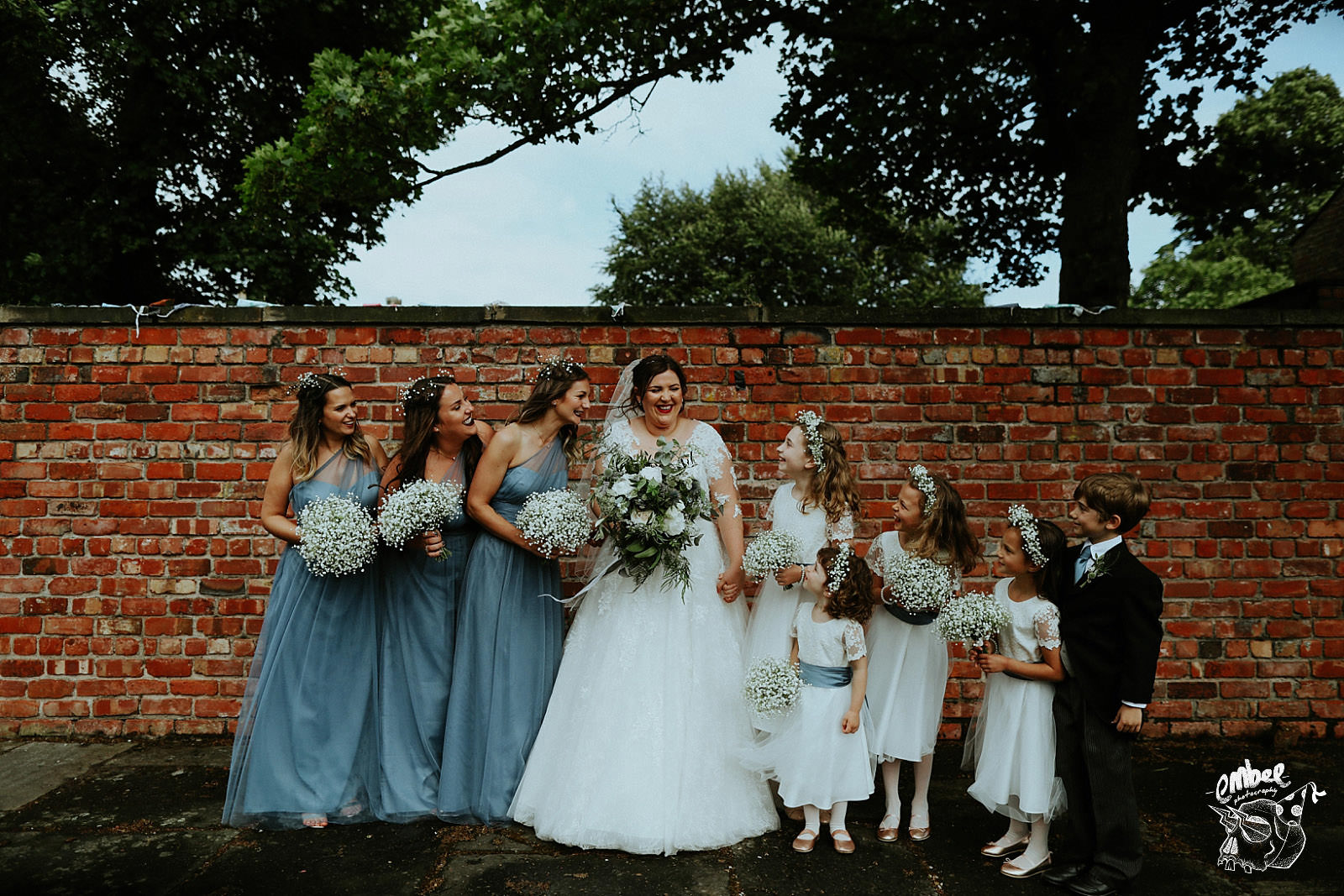 boho bride with flower girls at meols hall